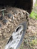 Mud covered tire Royalty Free Stock Photos