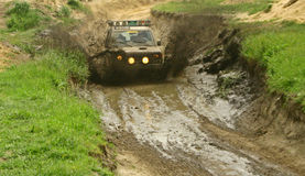 Mud devourer. Too fast for mud road Stock Image