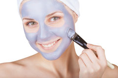 Mud face mask Stock Images