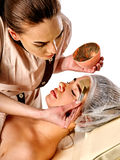 Mud facial mask of woman in spa salon. Face massage . Royalty Free Stock Photography