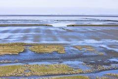 Mud flat of dutch Waddenzee near Noordkaap, Groningen Stock Images