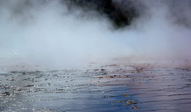Mud Flats and Steam. Grand Prismatic Hot Spring colorful mud flats with steam from spring - Yellowstone National Park, Wyoming stock images