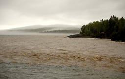 Mud, flod och dimma Arkivfoto