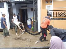Mud floods. Residents clean up the remaining mud floods at a village in Karanganyar Central Java, Indonesia Royalty Free Stock Photography