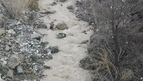 Mud flow mountain stream spring stormy water stock video