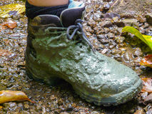 Mud on hiking shoe after trek in jungle Royalty Free Stock Images