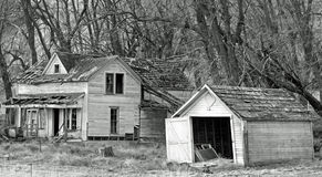 Mud Hollow House & garoge B/W. This House is on a road called mud hollow in north Centro Oregon. I don't know any thing about it just that it is cool old house Royalty Free Stock Photo