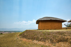 Mud house with satellite in the mountains Stock Image