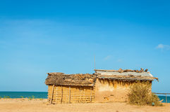 Mud Hut on a Beach stock images