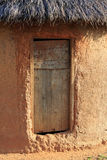 Mud hut wooden door. Simple mud hut with a wooden door Royalty Free Stock Photo