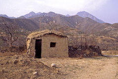 Mud Hut in Yanshan Mountains  27121. Primitive Mud Hut in Yanshan Mountains North of Beijing, China  27121 Royalty Free Stock Photos