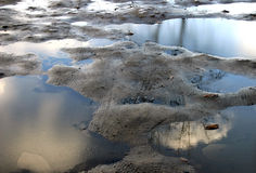 Mud islands. Mud and puddles reflecting the sky stock photography