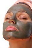 Mud mask. Face of young woman with mud mask on it Royalty Free Stock Photo
