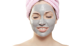 Mud mask. A young beautiful girl with mud mask on face Stock Image