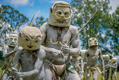 Mud men. Goroka, Papua New Guinea- September 18, 2005: A group of Mud Men ,carrying bows and spears ,dance at a Sing Sing at Goroka , Papua New Guinea Royalty Free Stock Photography