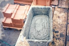 Mud pan with cement, mortar and tools for bricklaying on construction site Stock Photography