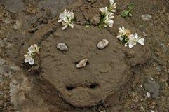 Mud pie woman. Head of a mud pie woman Royalty Free Stock Photos