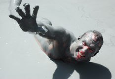Mud pleusure. Man getting mud-baths on Turkey resort Royalty Free Stock Photos