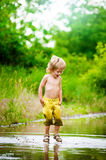 Mud puddle boy Stock Photo