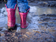 Mud puddle fun Royalty Free Stock Image