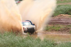 Mud Race. Four wheel Drive Truck raceing through mud Stock Photography