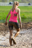 Mud race. A girl during a mud race Stock Photography