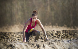 Mud race. A girl during a mudrace in Holland Royalty Free Stock Image