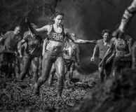 Mud race. A girl during a mudrace in Holland Stock Images