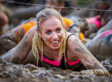 Mud race. A girl during a mudrace in Holland Royalty Free Stock Images
