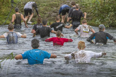 Mud race. Crossing a stream during a mudrace in Holland Royalty Free Stock Images