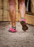 Mud race runner's muddy feet Stock Photography