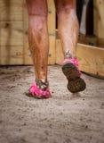 Mud race runner's muddy feet Stock Photography
