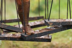 Mud race runners. During extreme obstacle races stock images