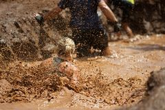 Mud race runners. During extreme obstacle races royalty free stock photo