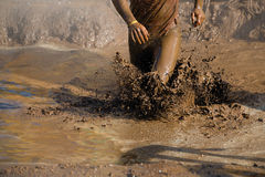 Mud race runners Royalty Free Stock Photo