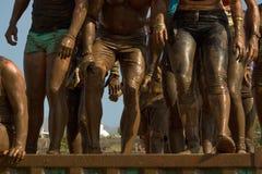Mud race runners Stock Photos
