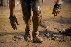 Mud race runners Stock Photos