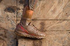 Mud race runners muddy feet Royalty Free Stock Photo
