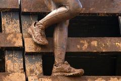 Mud race runners muddy feet Stock Photography