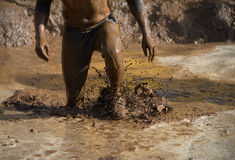 Mud race runners Stock Photography