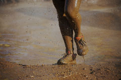Mud race runners Royalty Free Stock Photos