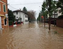 Mud River invades the road completely submerged during the flood Stock Photos