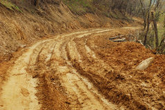 Mud road. Curve of a  mud road Royalty Free Stock Photography