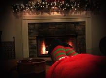 Warm Feet. Mug and Christmas Socks by the Fireplace Royalty Free Stock Photo
