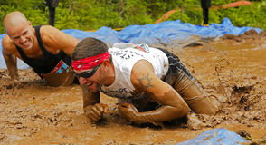 Mud Run Two Men Crawl Royalty Free Stock Image