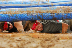 Mud Run Two Men Pole Water Stock Image