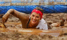 Mud Run Woman Wet Obstacle. Alexandra Sorensen moves through the mud and water at the Mud Run for Heart July 25, 2015, Waterford, New Brunswick, Canada Royalty Free Stock Photos