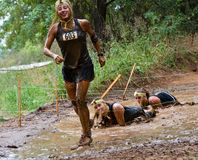 Mud runner passing mud pit Stock Photo