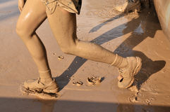 Mud running. Dirty mud running in the competition Royalty Free Stock Photography