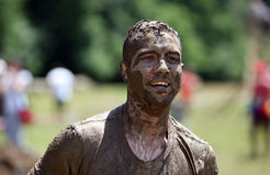 Mud running. People compete in a mud and obstacles run, in Bucharest, Romania Stock Photos
